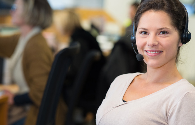 woman in security monitoring center wearing headset